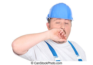 Construction man yawning