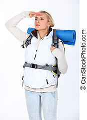 blond woman with camping backpack