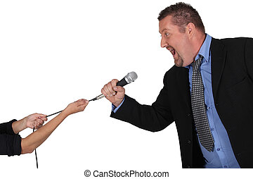 Businessman struggling to keep hold of a microphone