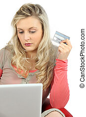 Young woman using a credit card online