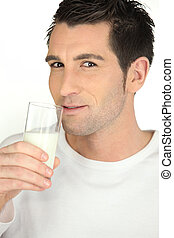 Young man with a glass of milk