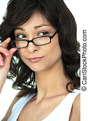 Attractive woman peering over her glasses