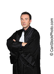 Man in graduation robes with arms folded