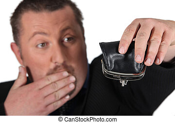 Man holding empty purse