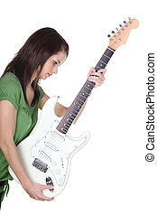 Brunette girl holding electric guitar