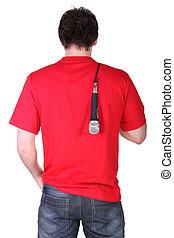 Man resting microphone over shoulder