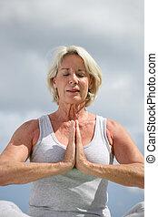 Senior woman meditating