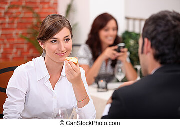 Couple enjoying meal in a restaurant