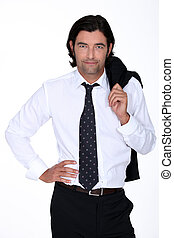Good looking man in a suit holding his jacket over his...