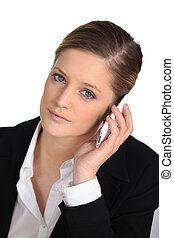 Young businesswoman listening to her cellphone