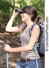 young woman backpacking and watching landscapes with...