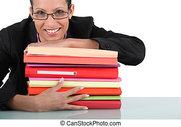 Secretary with a stack of folders