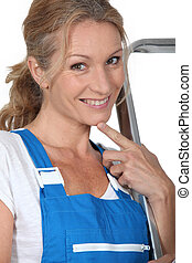 Woman in blue overalls