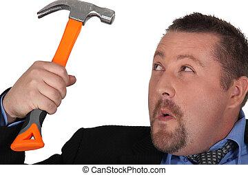 Businessman holding a hammer