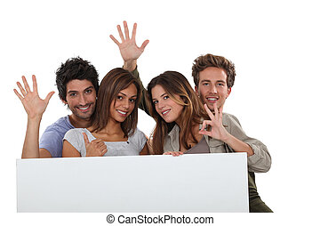 four young positive people