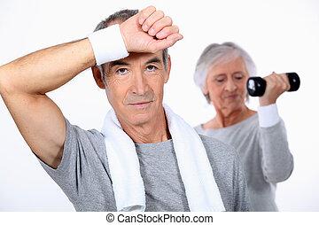 senior couple doing fitness