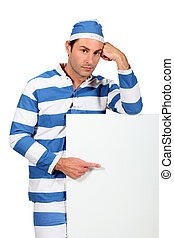 Prisoner pointing at white board
