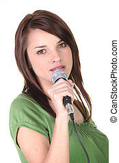 Brunette holding microphone