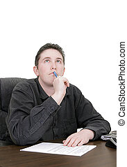 working man thinking - guy thinking as he works on paperwork