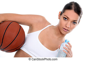 Woman with a basketball and bottle of water