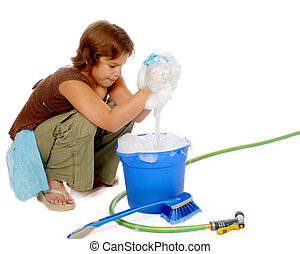 Young Scrubber - Older elementary girl wringing a soapy...