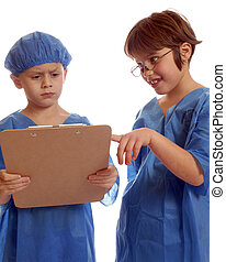 Play Docs Consulting - Two children in scrubs studying data...