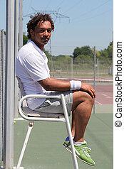 Umpire on tennis court