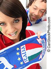 Couple supporting the Italian soccer team