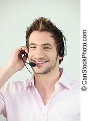 Young smiley man wearing a headset