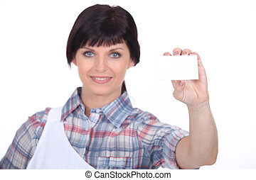 Butcher holding up her business card