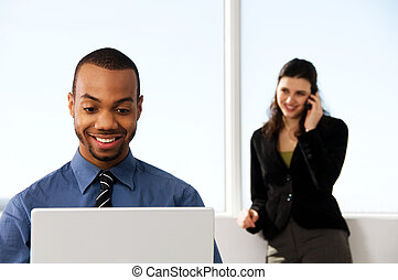 Business Couple - male and female business partners in a...