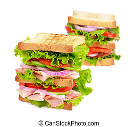 Sandwich with bacon and vegetables.