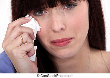 Woman crying with a tissue