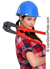 Female construction worker holding a pair of heavy-duty...