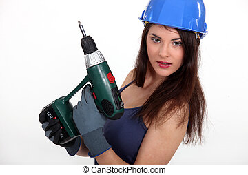 Woman with a cordless screwdriver