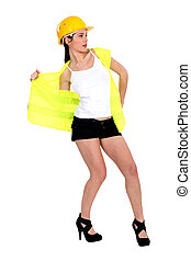 Woman taking off her reflective worker vest