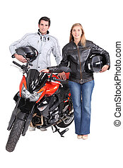 man and woman with motorbike