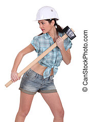 Sexy construction worker with a sledgehammer.