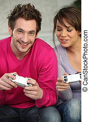 Young playing with console