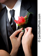 grooms wedding flower - a helping hand - putting the flower...