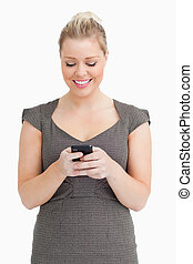 Woman texting on her smartphone