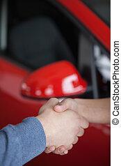 Hand shake in a car shop