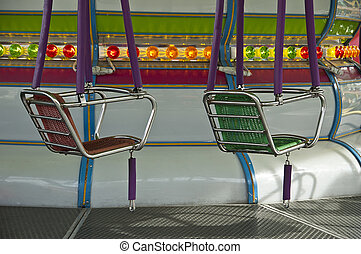 Luna Park - seats of the carousel at Luna Park and the...