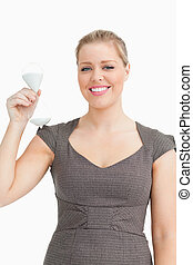 Woman smiling showing a hourglass in her hand