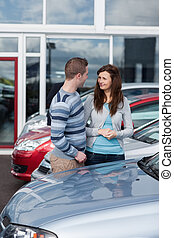 Couple buying a car in a dealership