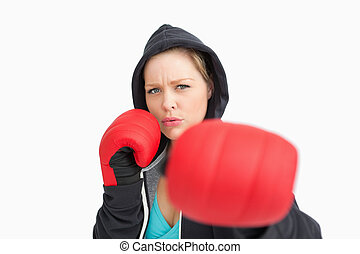 Woman with gloves hitting against white background