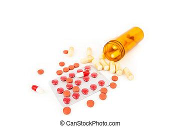 Bottle of medications knocked over against white background