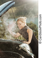fight - portrait of young beautiful woman with broken car...