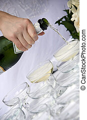champagne toast - wedding - waiter pouring champagne for a...