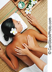 massage - portrait of young beautiful woman back in spa...